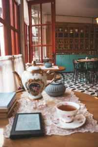 mug of beverage on white saucer
