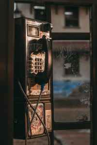 black and gray telephone booth