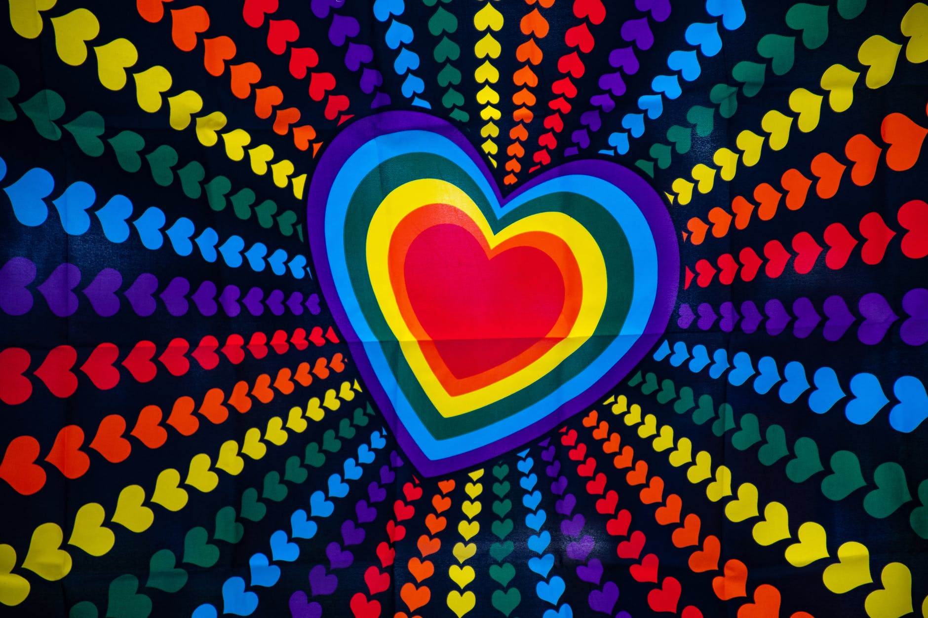 blue purple red and yellow heart printed poster