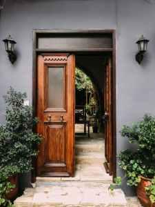 opened brown wooden french door
